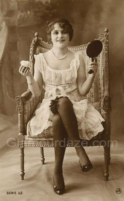 1918-woman-with-makeup-mirror