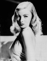"Veronica Lake is shown when she was the ""peek-a-boo look"" movie star in the 1940s. In March 1962, she lived in a New York hotel and worked for tips and her meals as a waitress and part-time hostess in the hotel's cocktail lounge. (AP Photo)"